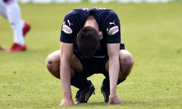 Dundee's Cammy Kerr trudges off the field following relegation from the Ladbrokes Premiership.