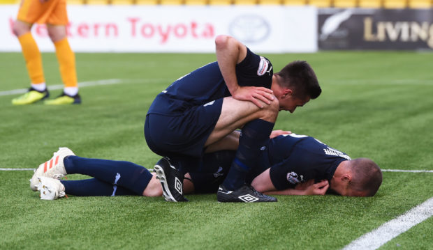 Kenny Miller gets injured as he opens the scoring.