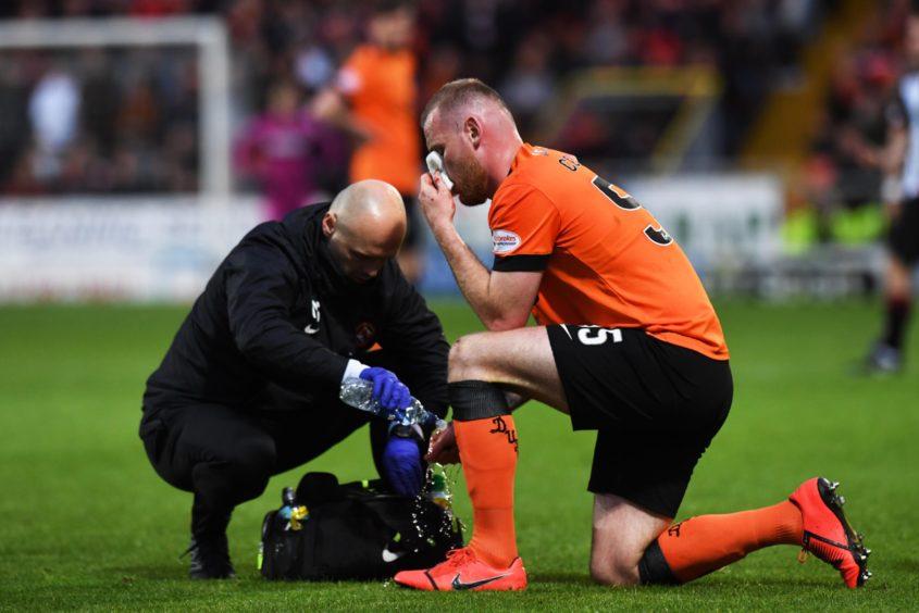 Mark Connolly receives treatment for a head knock.