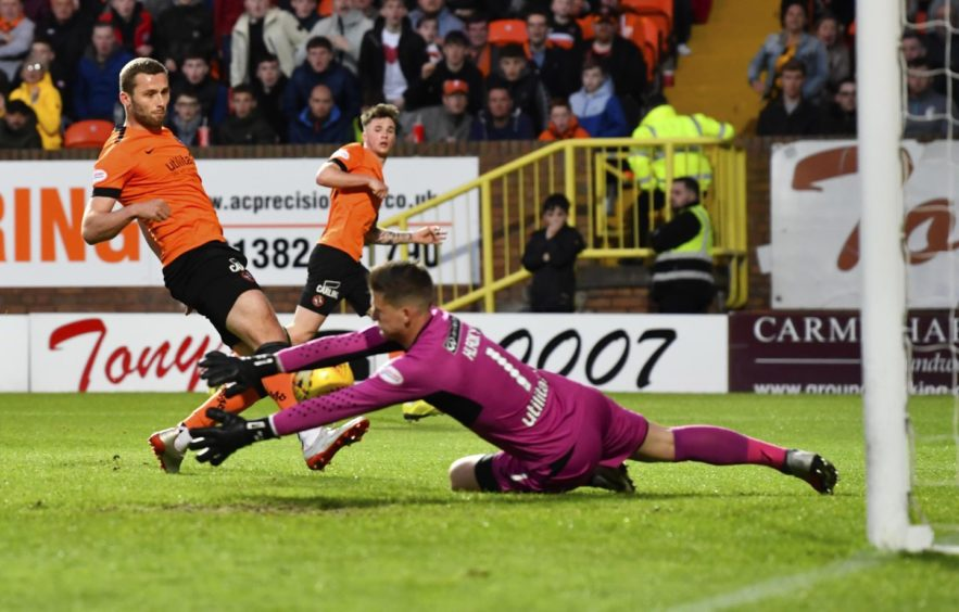 St Mirren keeper Vaclav Hladky makes a late save from Pavol Safranko.