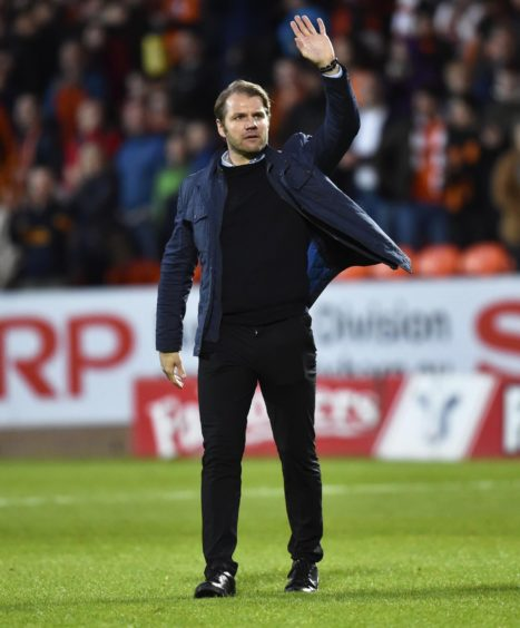 United manager salutes the home fans.