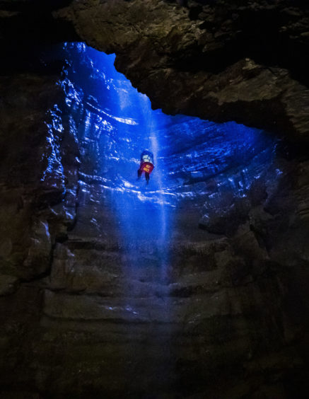 A potholer is winched into Gaping Gill, the largest cavern in Britain, situated in Yorkshire Dales National Park, ahead of its opening the public next weekend.