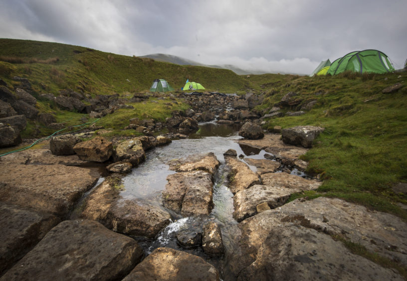 The Fell Beck runs through a campsite close to the entrance of Gaping Gill, the largest cavern in Britain, situated in Yorkshire Dales National Park, ahead of its opening the public next weekend.