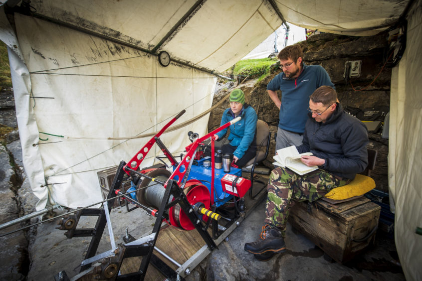 A winched lowers a potholer into Gaping Gill, the largest cavern in Britain, situated in Yorkshire Dales National Park, ahead of its opening the public next weekend.