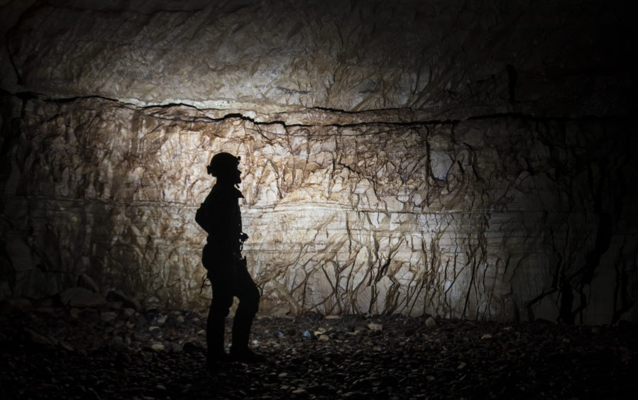 A potholer explores Gaping Gill, the largest cavern in Britain, situated in Yorkshire Dales National Park, ahead of its opening the public next weekend