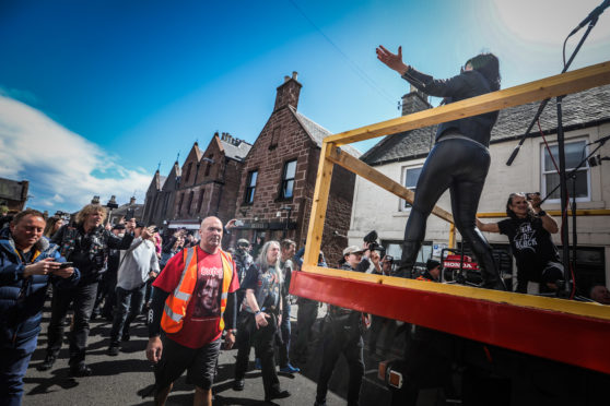 'Back N Black' on the 2019 Long Way To The top float which drives through the town centre.