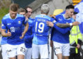 The St Johnstone players celebrate Scott Tanser's goal.