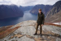 Professor Brian Cox on location at Stegastein, overlooking Aurlandsfjorden in Norway.
