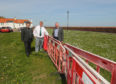 From left, councillors David Graham, Colin Davidson and Ken Caldwell at the barriers in West Wemyss
