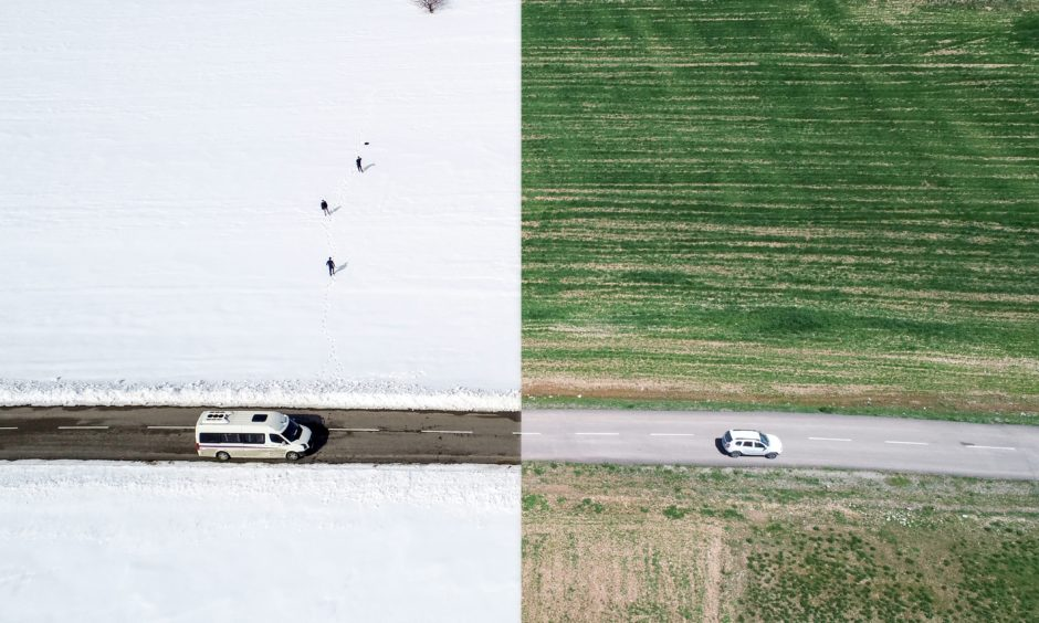 Drone photos show changing seasons in single photo with the combination of winter view with snow covered fields and greeny summer view on the road of Abali Ski Center in Van province of Turkey.
