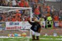 Deewok at a previous Dundee derby match