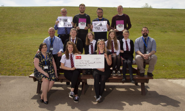 3rd year pupils and teachers involved in the fundraising pictured with Clic Sargeant's Donna Bednarek