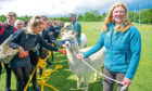 The school pupils meet the alpacas led by Graeme Nicoll and Lou Nicoll (foreground), Monifieth High School.