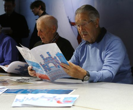 Jim Houston, right, and Ronald Milne look through Memory Exchange Dundee's Waterfront
