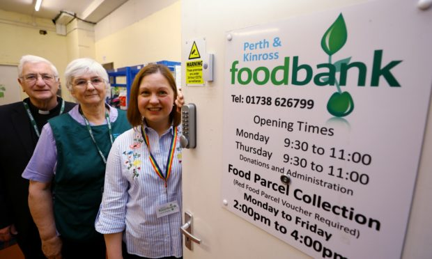 Perth and Kinross Foodbank Chairman Rev. Michael Archibald,  volunteer Rhona Archibald and project coordinator,  Lynn-Marie Neil are looking forward to the initiative with Perth Radio Taxis.