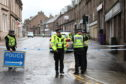 Police officers at the scene in Brechin yesterday morning.