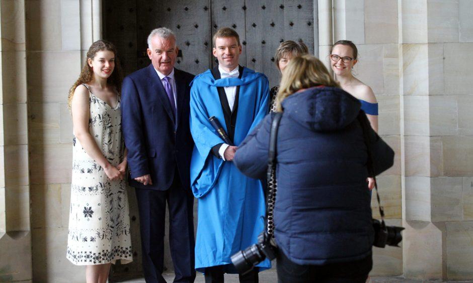 One graduate gets their photo taken.