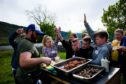 Pupils queue up for the game barbecue.