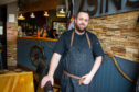 Scott Learmonth in his restaurant where he has introduced a phone ban to encourage his customers to talk to each other.