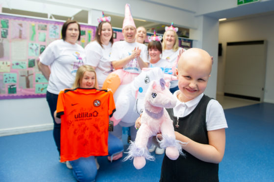 Back l to r - Marie McGregor, Jodie Hay (kneeling), Siobhan Paddick, Melanie Lochrie, Michelle Shepeherd, Cheryl Devaney and Lynsay Dow are all walking for Ruby (front)