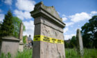 Tombstones in need of repair have been wrapped with safety tape at Greyfriars Burial Ground.