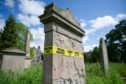 Some of the unstable headstones which are marked with safety tape at Greyfriars Burial Ground, Canal Street, Perth.