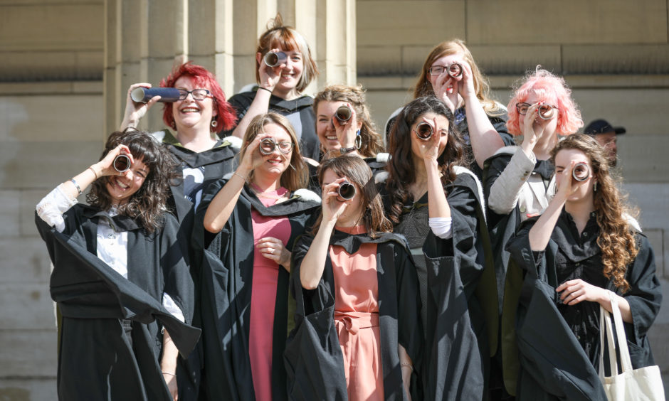 Jewellery design students celebrating after the afternoon graduation from University of Dundee.
