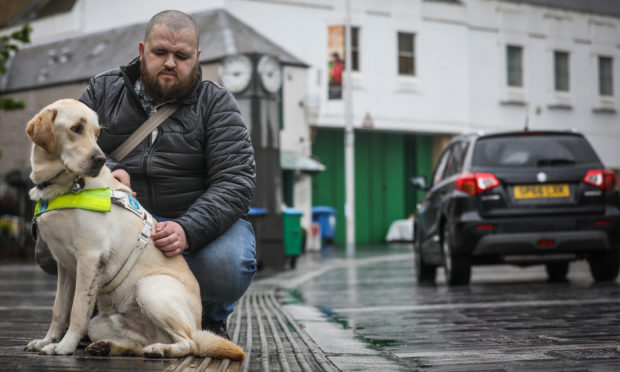 Jonathan Attenborough with guide dog Sam on Mill Street, where there are no kerbs to differentiate between road and pavement.