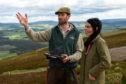 Merlin Becker shows Gayle Ritchie around the Game and Wildlife Scottish Demonstration Farm of Auchnerran near Logie Coldstone.