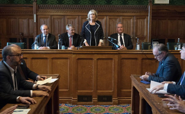 Dame Cheryl Gillan (Centre) with Charles Walker (centre left) and Bob Blackman (centre right) reads out the results of the first ballot in the Tory leadership ballot at the Houses of Parliament in Westminster, London.