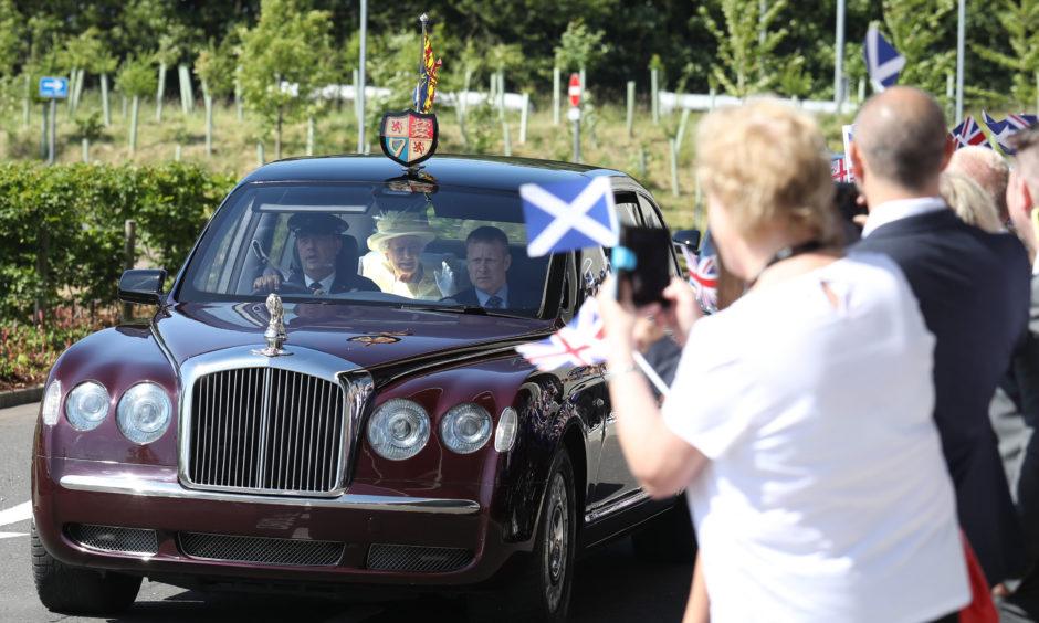 Queen Elizabeth II arrives at Greenfaulds High School in the west of Cumbernauld.