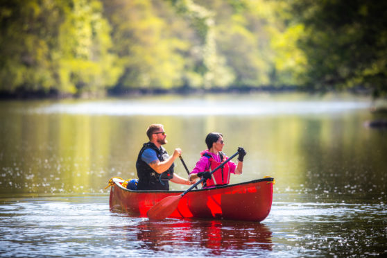 Gayle Ritchie and Ross Dempster in a canoe on River Lyon.