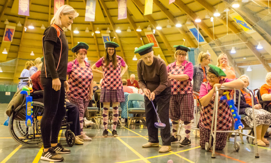 Some action from the event. Betty Cowie putting alongside staff from RDM Care Home, Scone.  All pictures by Steve MacDougall / DCT Media