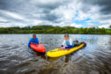 Gayle Ritchie and Dean Dunbar on prone boards at Clunie Loch.