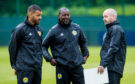 Steven Reid (left) chats with assistant Alex Dyer and manager Steve Clarke.