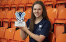 Neve Guthrie with her award.