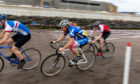Cyclists compete by racing the track in the wet sand. Steve Brown / DCT Media