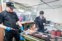 Mark Alland and Claire Pollock on the barbecue at Crail Food Festival.