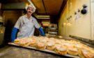 Baker Stewart Barnett with a tray of freshly made fruit scones.