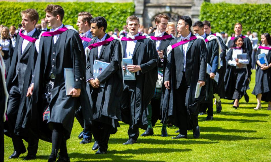 Graduates take part in the procession to St Salvators Quad.