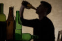 Adults who buy alcohol for underage drinkers could face jail