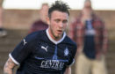 Jordan McGhee in action for Falkirk.
