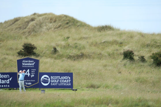 Robert MacIntyre tees off at the 4th during Day 1 of the Aberdeen Standard Investments Scottish Open at The Renaissance Club.