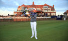 Bernd Wiesberger of Austria holds the Scottish Open trophy in front of the Renaissance clubhouse.