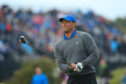 Tiger Woods struggled through a bad back and the cool, wet conditions at Royal Portrush.