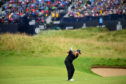 Shane Lowry of Ireland plays his second shot on the 18th hole.