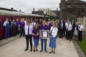 Socity volunteers (l-r) Ragnall Simmons, Kirsty Soutar and Andrew Pegg with Angus Lord Lieutenant Mrs Georgiana Osborne.
