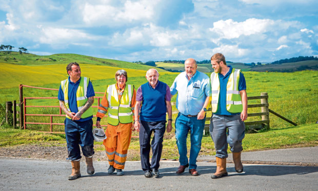 Binn Group staff Michael Kemp and Janet Ritchie with chairman John MacGregor, chief executive  Allan MacGregor and employee David Russell.