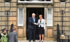 Scotland's First Minister Nicola Sturgeon welcomes Prime Minister Boris Johnson outside Bute House on July 29, 2019.