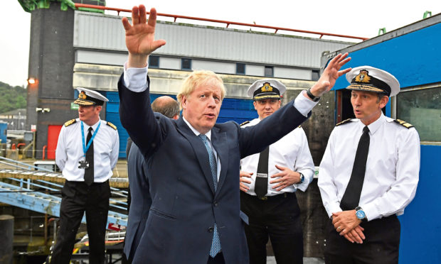 Britain's Prime Minister Boris Johnson gestures as visits HMS Victorious at HM Naval Base Clyde on July 29, 2019 in Faslane, Scotland.